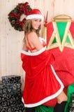 Beautiful woman wearing santa claus clothes Royalty Free Stock Images
