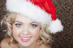 Beautiful Woman wearing a Santa Hat Stock Photography