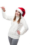 Beautiful woman wearing a santa hat smiling with christmas ball Royalty Free Stock Photo