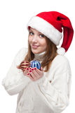 Beautiful woman wearing a santa hat smiling with christmas balls Stock Photography