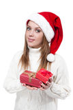 Beautiful woman wearing a santa hat smiling with gifts Royalty Free Stock Photo