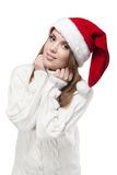 Beautiful woman wearing a santa hat smiling Stock Photos
