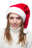Beautiful woman wearing a santa hat smiling Stock Images