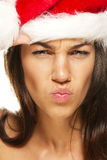 Beautiful woman wearing santas hat looking angry Royalty Free Stock Photos