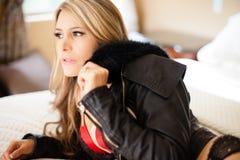 Beautiful woman wearing a sexy black jacket Stock Image