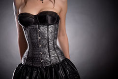 Beautiful woman wearing silver corset with stars Stock Image