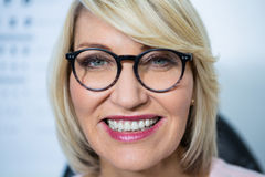 Beautiful woman wearing spectacles in optical store Royalty Free Stock Images