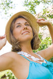 Beautiful woman wearing a straw hat Stock Photo