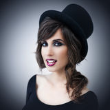 Beautiful Woman Wearing a Top Hat Stock Photo