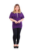 Beautiful woman wearing violet t-shirt stands Stock Photography
