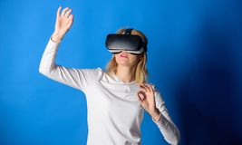 Beautiful woman wearing virtual reality goggles in studio. Woman using virtual reality headset. Happy woman exploring. Augmented world, interacting with digital royalty free stock photos