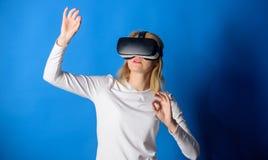 Beautiful woman wearing virtual reality goggles in studio. Woman using virtual reality headset. Happy woman exploring. Augmented world, interacting with digital royalty free stock photos