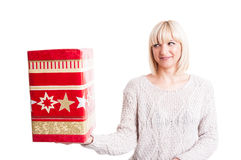 Beautiful woman wearing warm sweater holding a present Royalty Free Stock Images