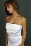 Beautiful woman wearing a white dress Stock Images