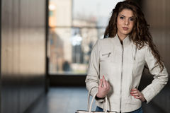 Beautiful Woman  Wearing White Leather Jacket Royalty Free Stock Photography