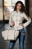 Beautiful Woman  Wearing White Leather Jacket Stock Photography