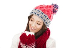 Beautiful woman wearing winter clothing and holding coffee cup Stock Image