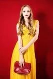 Beautiful Woman wearing Yellow Dress on Bright Background Stock Photos