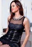 Beautiful woman wearingl black dress Royalty Free Stock Photos