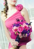 Woman with bouquet of roses Stock Photos