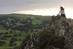 A Beautiful Woman on a Welsh Crag Stock Image