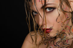 Beautiful woman with wet hair and face art Royalty Free Stock Photo