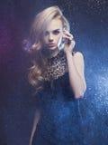 Beautiful woman through the wet window Stock Photography