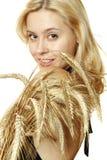Beautiful woman with wheat Stock Photography