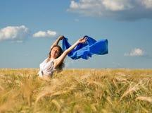 Beautiful woman on a wheat field Stock Photography