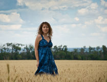 Beautiful woman on a wheat field Royalty Free Stock Photo