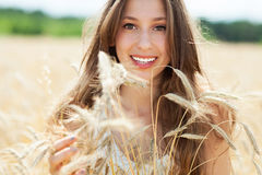 Beautiful woman in the wheat field Stock Photo
