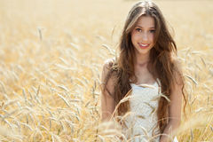 Beautiful woman in the wheat field Royalty Free Stock Photo