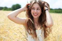 Beautiful woman in the wheat field Stock Images