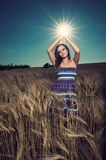 Beautiful woman in wheat field holding sun Stock Images