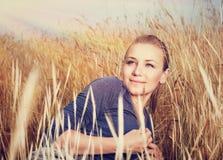 Beautiful woman in wheat field Royalty Free Stock Photo