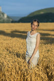 Beautiful woman in wheat at sunset. Stock Images