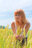 Beautiful woman at wheatfield Stock Photo