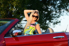 Beautiful woman at the wheel the red car Royalty Free Stock Photography