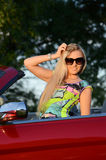 The beautiful woman at the wheel the red car Royalty Free Stock Photography