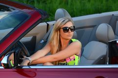 The beautiful woman at the wheel the red car Royalty Free Stock Images
