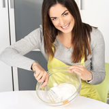 Beautiful woman whisking batter Royalty Free Stock Images