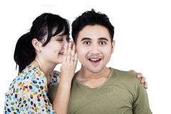 Beautiful woman whispering to boyfriend Stock Photography