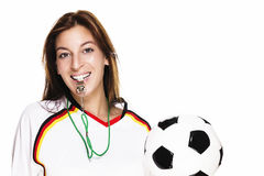 Beautiful woman with a whistle holding football Stock Photography