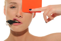 Beautiful woman with whistle and red card Royalty Free Stock Image