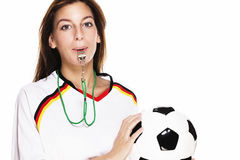 Beautiful woman with a whistle wearing football sh Royalty Free Stock Photos