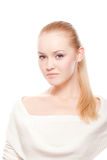 Beautiful woman on white. Attractive young caucasian adult isolated on white background ponytail serious focused Stock Photography