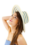 Beautiful woman on white background with long hair and hat look Stock Image