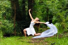 Beautiful woman in white Stock Images