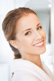 Beautiful woman in white bathrobe Royalty Free Stock Images
