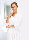 Beautiful woman in white bathrobe Royalty Free Stock Photo